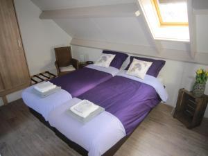 Een bed of bedden in een kamer bij B&B De Bloesemhof