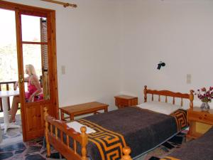 A bed or beds in a room at Villa Christos
