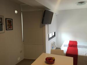Una cama o camas en una habitación de Estudio San Lorenzo