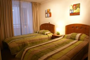 Cama o camas de una habitación en Apart Hotel Agustinas Plaza