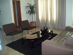 A seating area at Flat Residence bela Vista bueno