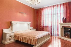 A bed or beds in a room at StudioMinsk 4 Apartments - Minsk