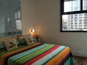 Tempat tidur dalam kamar di Studio Rio Beira Mar