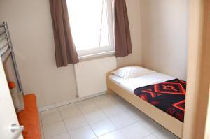 Een bed of bedden in een kamer bij Westhoek Apartments