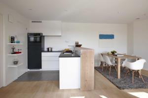 Küche/Küchenzeile in der Unterkunft Kustappartementen