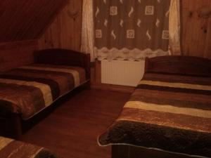 A bed or beds in a room at Pie draugiem