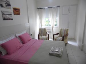 En eller flere senger på et rom på Apartamento Almirante Gonçalves