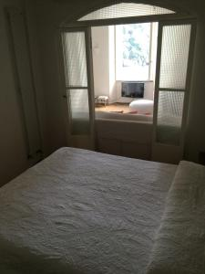A bed or beds in a room at Love in Portofino Apartment