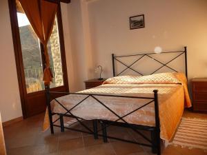 Letto o letti in una camera di Cascina Monsignore Azienda Agrituristica