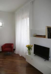 Una televisión o centro de entretenimiento en Residenza Pomponio