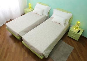 Cama o camas de una habitación en Residenza Pomponio