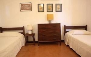 A bed or beds in a room at Cottage Morus