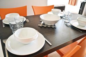 Restaurant ou autre lieu de restauration dans l'établissement ApartHotel Sainte-Marthe