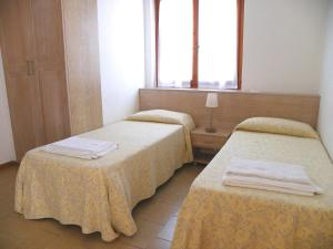 A bed or beds in a room at Residence Eucalipti