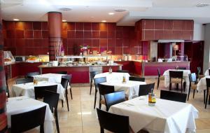 Um restaurante ou outro lugar para comer em Caybeach Caleta