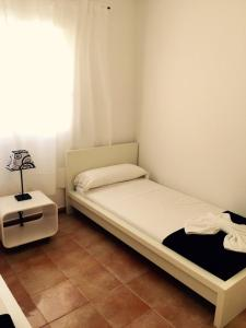 A bed or beds in a room at Villa Roca Llisa 2
