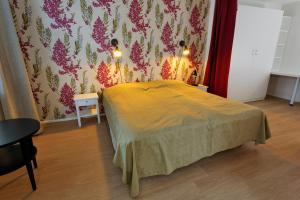 A bed or beds in a room at Forenom Serviced Apartments Helsinki Kruununhaka