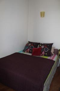 A bed or beds in a room at Appartement Centre Ville Ajaccio