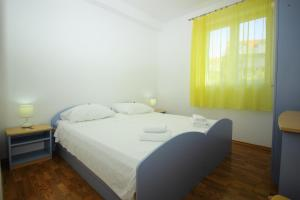 A bed or beds in a room at Bacan Serviced Apartments