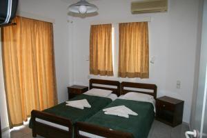 Ένα ή περισσότερα κρεβάτια σε δωμάτιο στο Litsa Mare Apartments