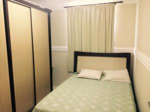 A bed or beds in a room at Apartamento em Aracaju - Sergipe