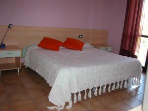 Letto o letti in una camera di Residence Perla Rosa