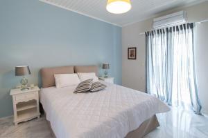 Ένα ή περισσότερα κρεβάτια σε δωμάτιο στο Marmara Studios