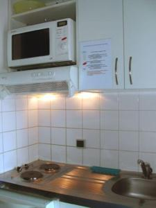 A kitchen or kitchenette at Aquabeach
