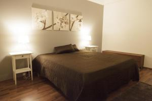 A bed or beds in a room at Helsinki Rentals Everstinkuja