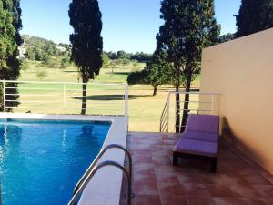 The swimming pool at or near Villa Roca Llisa 4