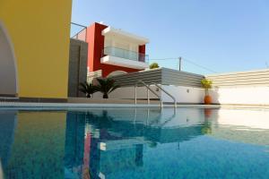 The swimming pool at or near Gennadi Aegean Horizon Villas