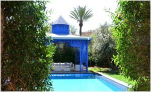 Het zwembad bij of vlak bij Villa Palmeraie