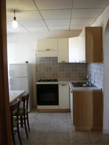 A kitchen or kitchenette at Casa Maria