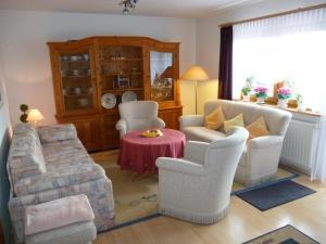 Ein Sitzbereich in der Unterkunft Ferienhaus Baller