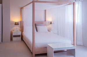 A bed or beds in a room at Milos Bay Suites