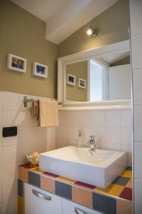 Ein Badezimmer in der Unterkunft Piazza Roma Rooms