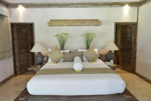 A bed or beds in a room at Sienna Villas