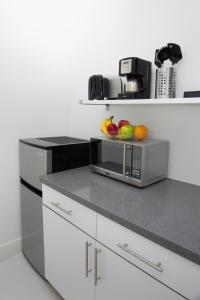 A kitchen or kitchenette at Beach Apartments by Design Suites