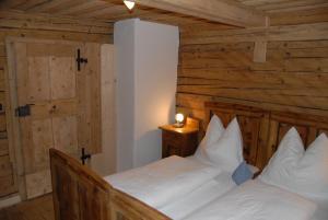 Ein Bett oder Betten in einem Zimmer der Unterkunft Ferienhaus Kramerl