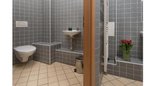 A bathroom at Old Town Residence Apartments