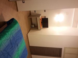 A television and/or entertainment center at Appartamento Valle dei Templi