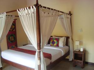 A bed or beds in a room at Bali Emerald Villas