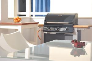 A kitchen or kitchenette at Apartamentos Alborada