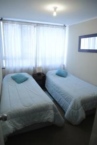 Cama o camas de una habitación en Santa Lucia Departamento Amoblado
