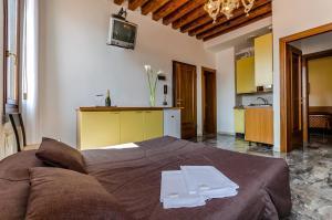 Letto o letti in una camera di Venice Apartments