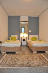 Кровать или кровати в номере Appartment Graz Zentrum
