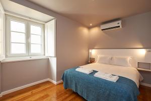 A bed or beds in a room at Portugal Ways Alfama River Apartments