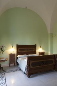 A bed or beds in a room at Villa Urso