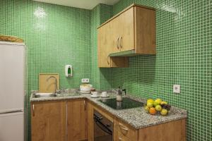 A kitchen or kitchenette at AinB Las Ramblas-Guardia Apartments