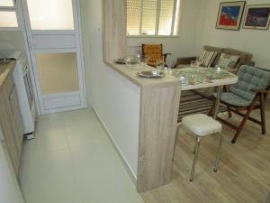 A kitchen or kitchenette at Apartamento Cristóvão